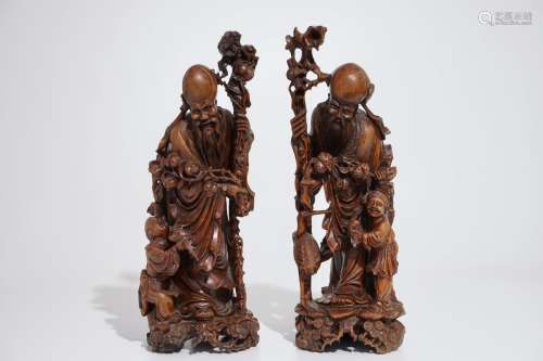 A pair of tall Chinese carved wood figures of immortals, 19/20th C.