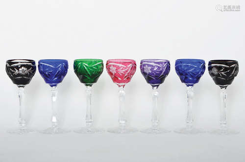 A SET OF SEVEN CUT TO CLEAR COLOR CRYSTAL LIQUER GOBLETS