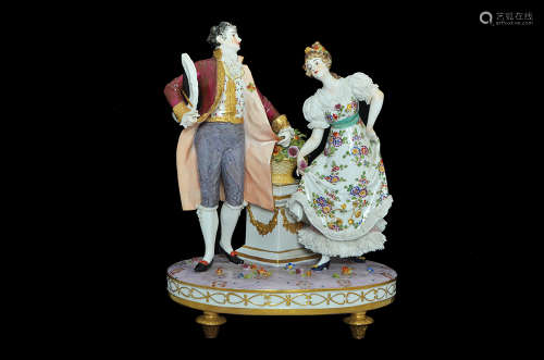 A CONTINENTAL EUROPEAN PORCELAIN FIGURE GROUP