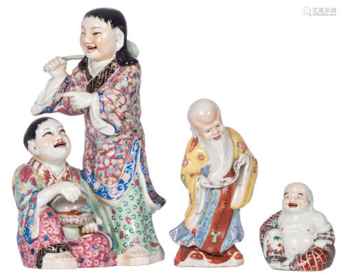 A Chinese polychrome decorated group, a Shou Xing figure and a Budai, H 11 - 34 cm