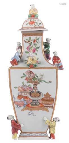 A quadrangular baluster shaped vase, relief decorated all over with Hé-Hé children and painted with chinoiseries in a famille rose palet, H 34 cm