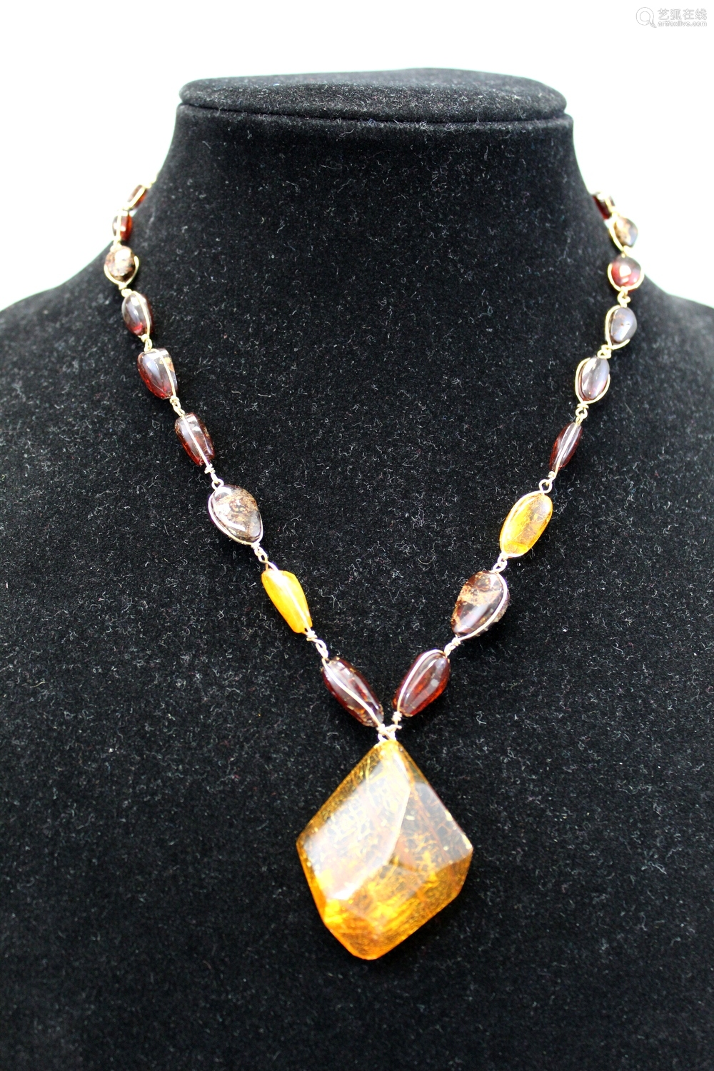 Natural amber necklace with big natural amber pendant.