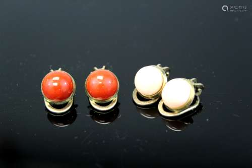 Two pairs of coral ear studs