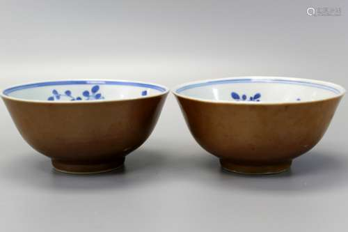 Pair of Chinese brown glazed bowls with interior blue and white decoration, Kangxi mark and of the period.