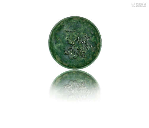 Qianlong A spinach green jade 'bats and peony' washer