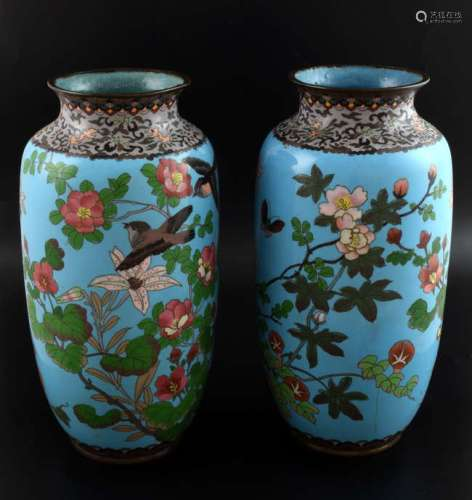 Pair of Chinese blue ground cloisonné vases decorated with birds amongst foliage, 31cm high,