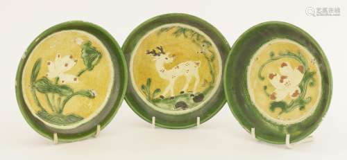 Three Chinese sancai saucers,  Liao dynasty (907-1125), painted with a deer with lingzhi in its ...