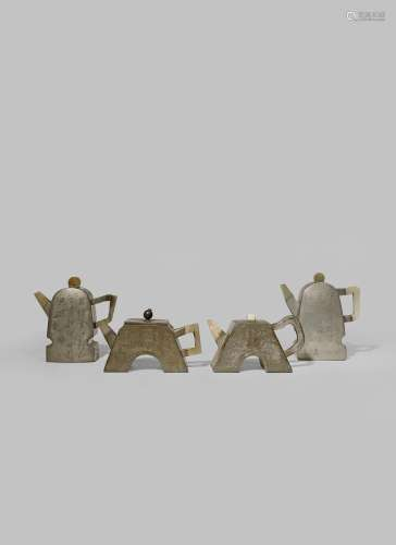 FOUR CHINESE INSCRIBED PEWTER-ENCASED YIXING TEAPOTS AND COVERS QING DYNASTY Three set with jade
