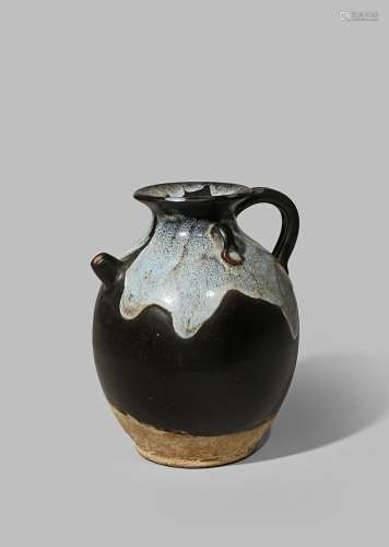 A CHINESE PHOSPHATIC GLAZED EWER TANG DYNASTY 618-907 AD With an ovoid brown glazed body with
