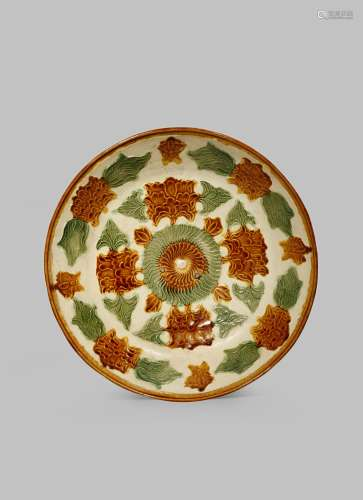 A CHINESE SANCAI MOULDED DISH LIAO DYNASTY 907-1125 AD Of circular form moulded with peony