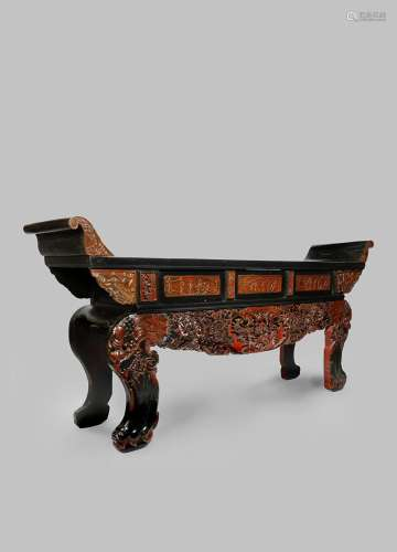 A MASSIVE CHINESE BLACK LACQUER AND RED PAINTED ALTAR TABLE 20TH CENTURY Boldly carved with panels