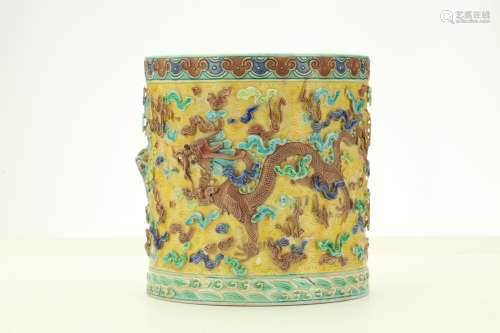 A CHINESE BISCUIT 'DRAGON' BRUSHPOT. Late Qing Dynasty. Decorated in high relief with three