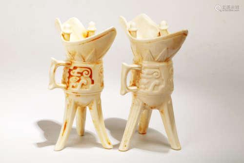 (2) A PAIR OF 'DEHUA' 'JUE'-FORM CUPS.C043