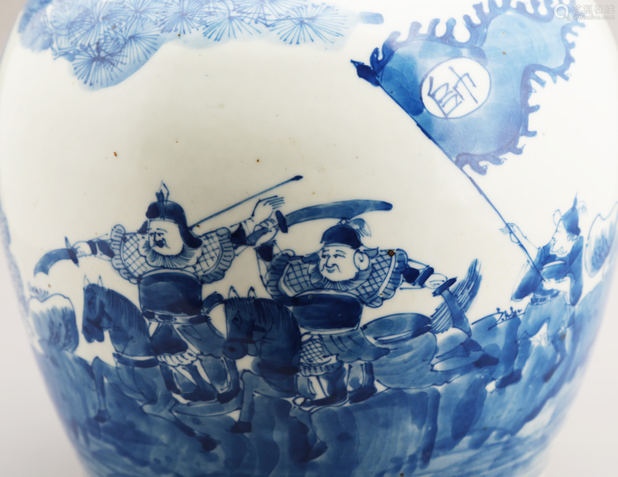 A BLUE AND WHITE FIGHTING SOLDIERS JAR.