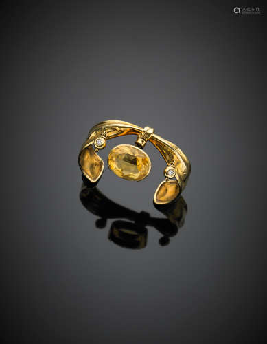MISANIYellow gold bangle with an oval citrine quartz and two diamond charms, g 27.00, diam. cm 5.4. Signed MISANI
