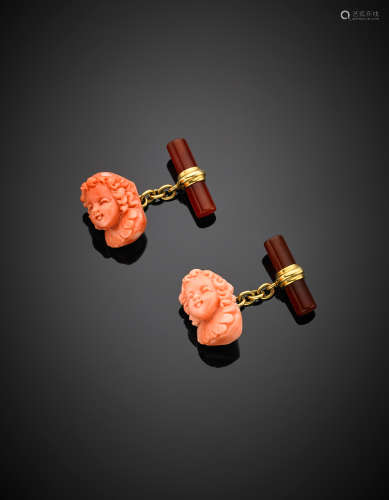 Yellow gold pink coral and carnelian carved head cufflinks, g 12.59.