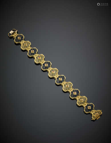 UNOAERREYellow gold blue enamel openwork modular bracelet, accented with rubies, g 34.10, length cm 19, h cm 1.80 circa. Marked UNOAERRE
