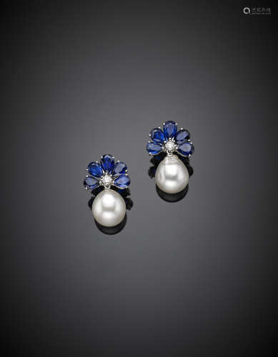 White gold ,sapphire South Sea pearl pearl pendant earrings, the pear sapphire set as a halo from which hangs the pearl drop, g 11.55, length cm 2 circa.