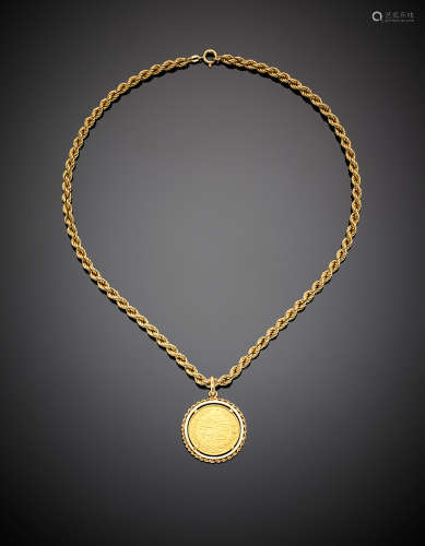 Yellow gold twisted rope necklace with Arab coin pendant, g 22.10, length cm 43.50 circa.