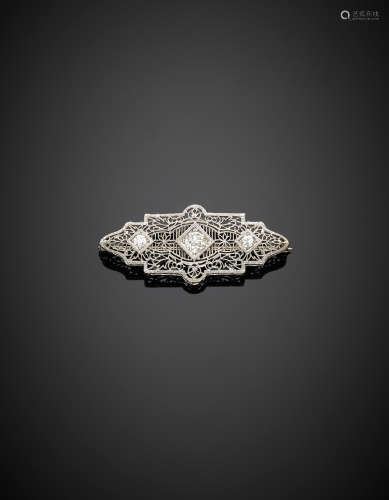Platinum filigree brooch with three diamond, the central ct. 0.80 circa and the others ct. 0.22 circa each, g 4.50.