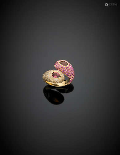 *A tourmaline cross-over bi-coloured gold ring with a pink sapphire pavé and tinted diamond surround g 14.00 size 14/54.
