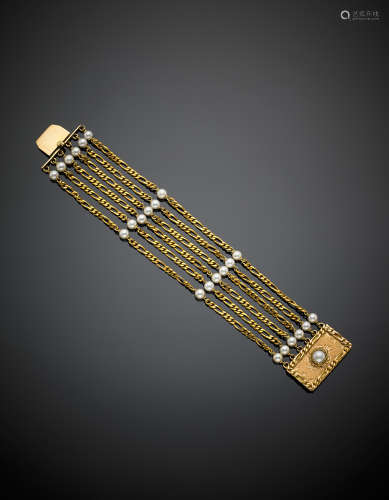 A five-strand chain yellow gold bracelet with pearl spacers and a mabé pearl on the clasp, g 41.60, length cm 18, h cm 3.10 circa.
