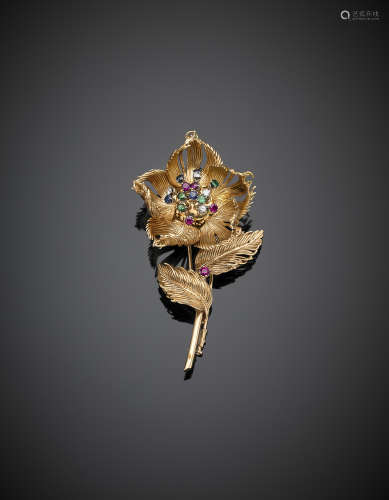 CARTIERPink gold diamond, sapphire, ruby and emerald accented flower brooch with shifting petals and pistils, g 34.68, length  cm 7.60 circa. Marcato CARTIER n.017295 In Cartier case not pertinent