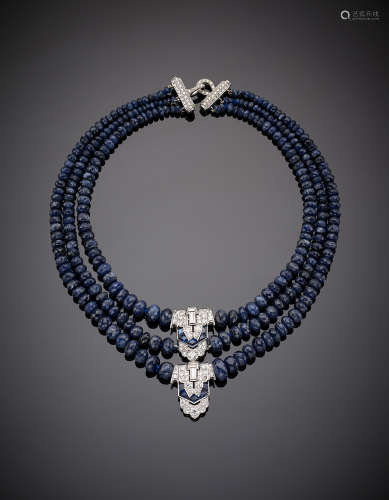 Three-strand graduated and faceted sapphire bead necklace with white gold round and baguette diamond and carré sapphire set central and clasp, g 138.10, length cm 40.50, h cm 6.00 circa.