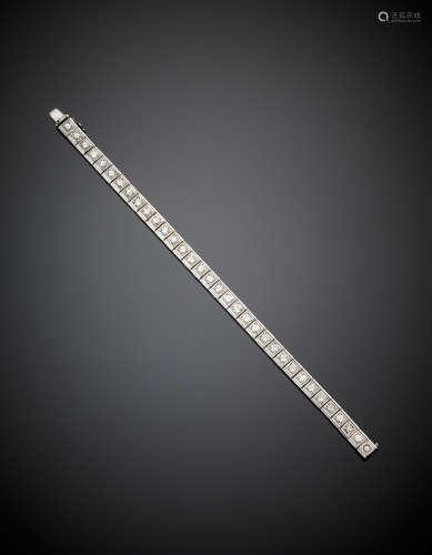 White gold square set round diamond bracelet, in all ct.5/5,50 circa, g 27.67, length cm 17.40 circa.