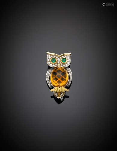 *MISSIAGLIABi-coloured gold diamond owl brooch, the body a citrine cabochon quartz and emeralds for the eyes, g 17.30, length cm 3.90 circa.