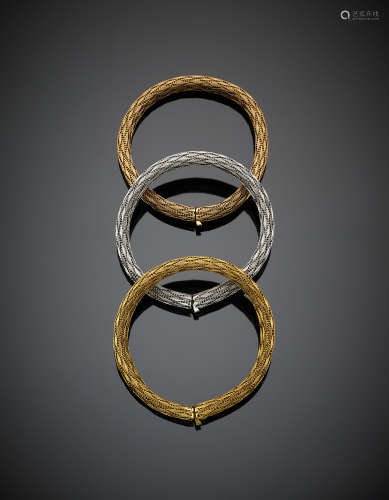 Three braided mesh bracelets in yellow, white and pink gold, in all g 97.4, length cm 19.3 circa.