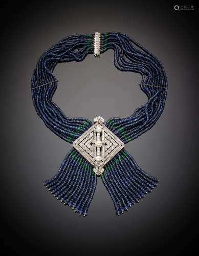 Multi strand faceted emerald and sapphire bead necklace, centered by a white gold diamond and pearl lozenge underlined by a fringe of the same beads, white gold diamond clasp, g 146.67, length cm 38.50 circa. French hallmarks Original case