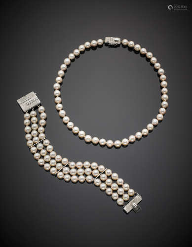 White pink-hued cultured pearl set composed by a necklace and a three strand bracelet each with white gold diamond clasp, in all g 72.60. Necklace length cm 39 bracelet cm 18.5