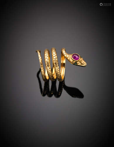 Yellow chiselled gold emerald and ruby accented coiled snake ring, g 10.04 size 10/50.