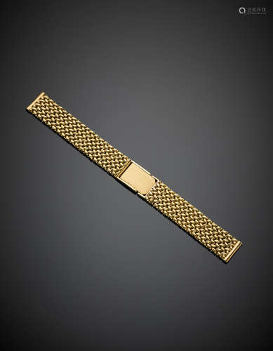 Yellow gold adjustable interlaced watch strap, g 34.60, length cm 15.50 circa.