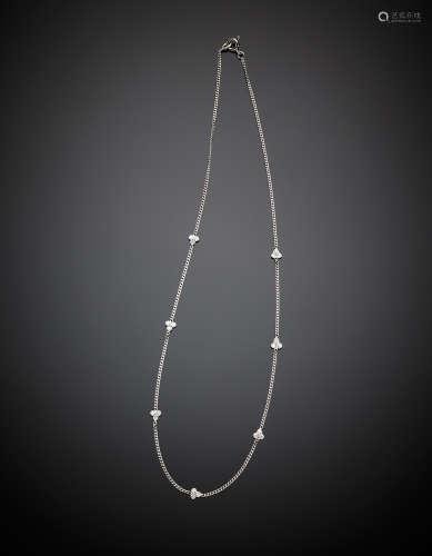 A white gold chain set with seven diamond clover motif diamonds,, in all ct. 0.30 circa, g 3.27, length cm 40 circa.