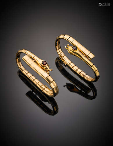 Yellow gold double articulated snake bracelets with red brown vitreous pastes for the eyes, in all g 82.50.