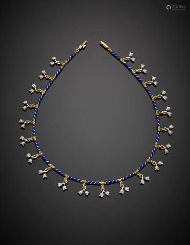 A bi-coloured gold necklace with blue enamel details accented with diamonds g 45.22, length cm 40.50 circa.
