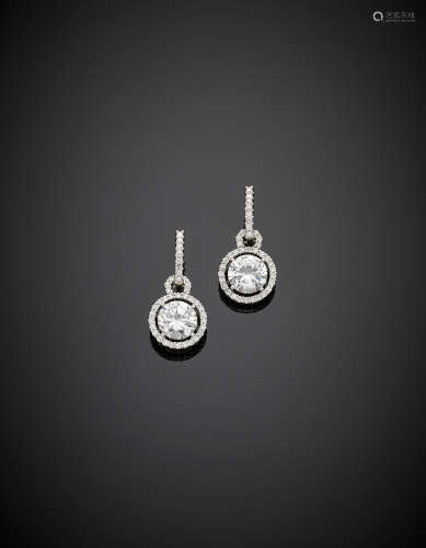White gold pendant earrings with diamond surrounding two colourless gems, g 9.12, length cm 3 circa.