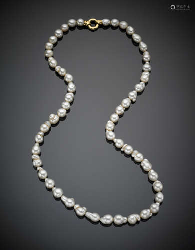Long graduated irregular pearl necklace with yellow gold clasp, g 119.4, length cm 76.56 circa.