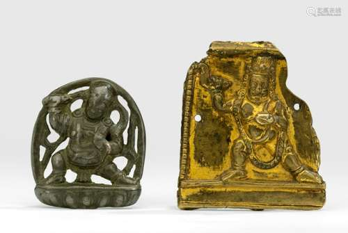 A GILT-COPPER PLAQUE WITH A WRATHFUL DIVINITY AND A METAL PLAQUE WITH VAJRAPANI