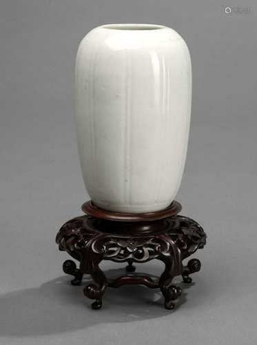 A SMALL WHITE SUBTLY LOBED VASE WITH WOOD STAND, China, 18th/19th ct. - Property from an old German private collection, assembled prior to 1990 -  Minor traces of age