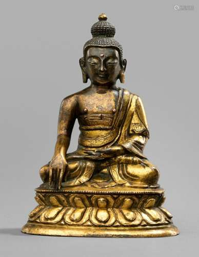 A GILT-BRONZE FIGURE OF BUDDHA SHAKYAMUNI, Tibeto-Chinesisch, 18th ct., seated in vajrasana on a lotus base with his right hand in bhumisparshamudra while the left is resting on his lap, wearing a monastic garment, his face displaying a serene expression with downcast eyes below arched eyebrows running into his nose-bridge, urna, his curled hair and ushnisha topped with a lotus-bud, resealed - Property from an important German private collection, bought from a Dutch collection 1974 - Minor wear