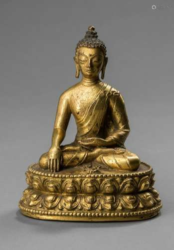 A GILT-BRONZE FIGURE OF BUDDHA AKSHOBHYA, TIBET, 17th/18th ct. Seated in vajrasana, dressed in a long draped robe, his hands in bhumisparshamudra, a small vajra placed on the base in front of him. - Former property from an Austrian private collection - Bowl lost, minor wear