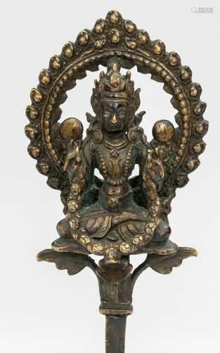 A BRONZE FIGURE OF AN OFFERING DEITY, Nepal, 18th/19th ct., on base. Seated in vajrasana on a lotus pericarp with both hands extending a garland, wearing a dhoti, bejewelled, his face displaying a serene expression with downcast silver inlaid eyes and a flaming halo behind - Property from a German private collection, assembled in the 1970s and 80s - Very slightly chipped, minor wear