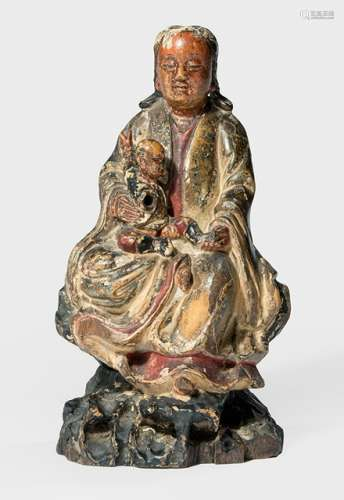 A POLYCHROME PAINTED WOODEN FIGURE OF GUANYIN SEATED ON A ROCK WITH BOY, China, early Qing dynasty - Property from an old German industrialist collection, assembled between 1950 and 1990 - Wear, slightly chipped, right hand of the boy lost