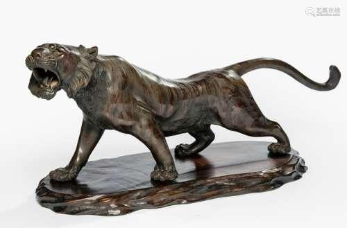 A BRONZE MODEL OF A ROARING TIGER