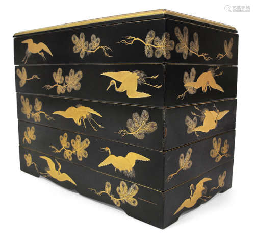 A FIVE-CASE LACQUER STAPLE BOX AND COVER DECORATED WITH CRANES AND PINE TWIGS IN GOLD LACQUER ON BLACK GROUND