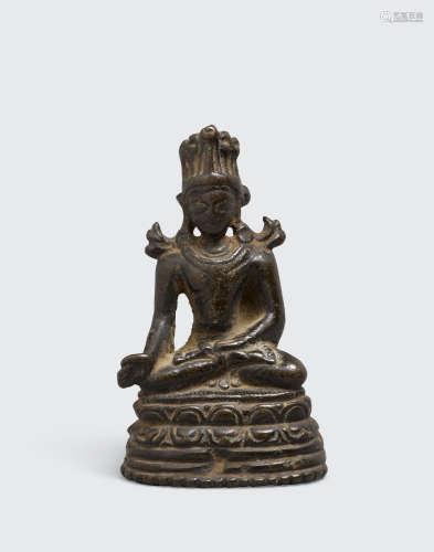 Tibet, Pala style, circa 12th century A Copper alloy figure of Ratnasambhava