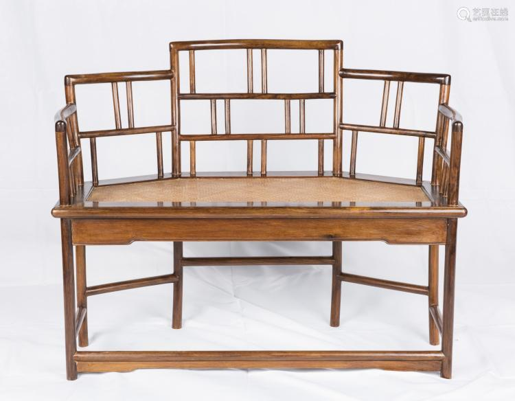 A CHINESE CARVED HUANGHUALI SETTEE
